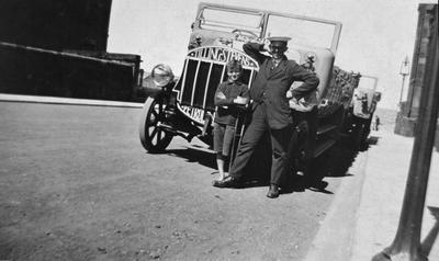 P15373; Driver and boy posing in front of Tilling Stevens Charabanc