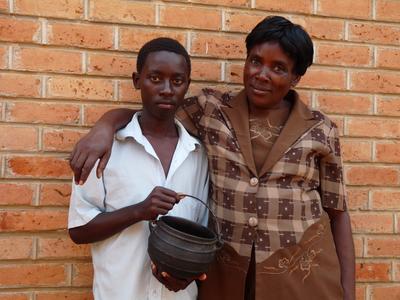 P56991; Rachel Msumba and her nephew Danson,  with her cooking pot