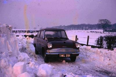 P60079; Car at Seafield Farm Rd in snow