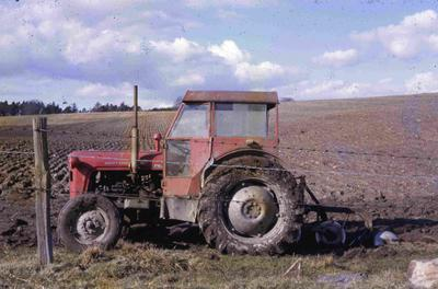 P60083; Tractor in field on Seafield Farm