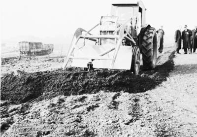 P22835; Digger moving soil