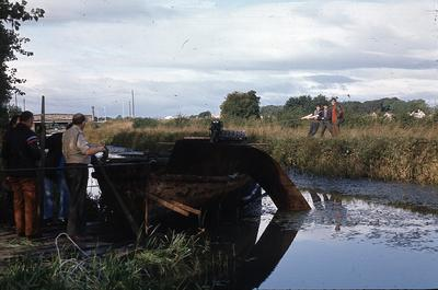 P02778; Staff and boys of HMI Polmont raising a salvaged barge from Union Canal