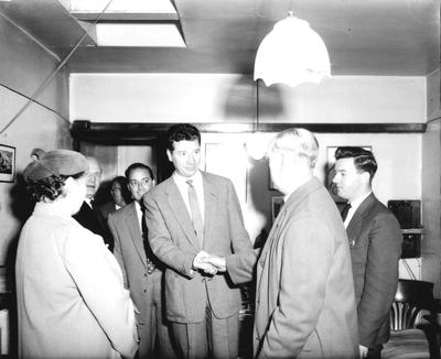 P33111; Max Bygraves shaking hands with an older man