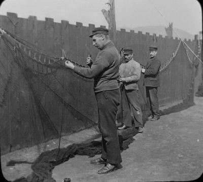 P16655; Fishermen mending nets, Campbeltown