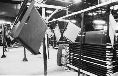 P31586; Ironfounding products hanging on drying/production line
