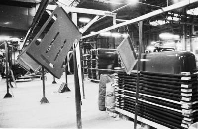 P31589; Ironfounding products hanging on drying/production line