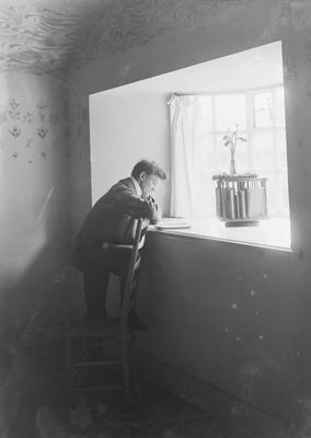 P11822; Edwardian man at windowsill