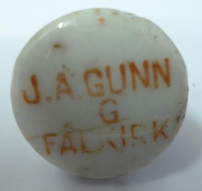 1986-065-001; bottle stopper (J.A. Gunn)