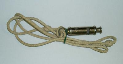 2002-015-004; whistle and lanyard