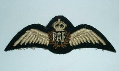 2002-022-001; badge