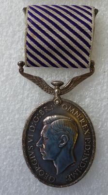 "2003-048-001; medal; ""Distinguished Flying Medal"""