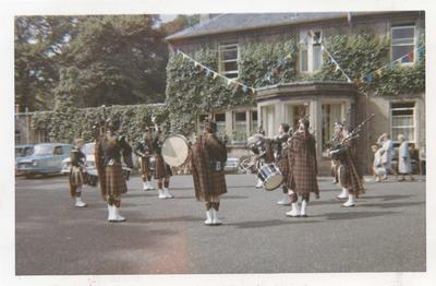 P56663; Pipe band in front of  Weedingshall Children's Home