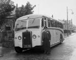 Driver standing beside Fitzcharles bus in Grangemouth