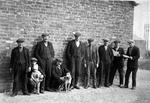 Group of men and child at Bothy Row, Carronshore