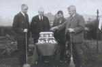 Members of Denny Curling Club examining Wright Trophy; holding brooms