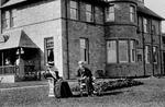 Edwardian couple sitting in front of Carron Grange