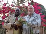Benford Mwakayuni and Brian McNeill with a cooking pot now uses as a plant pot