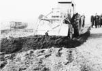 Digger moving soil