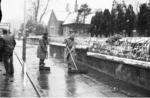 Men clearing snow and water