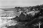 View of residential houses in front of Corbiehall Cemetery with Bo'ness in background.