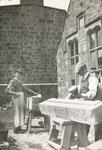 Masons working outside house