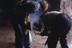 James Millar, farrier, with tools at forge
