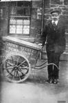 John Steele with a newsagent's handcart.