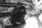 Worker (woman?) welding hopper sides to tank top, Grangemouth