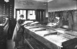 Camelon bus depot interior - conductress checking money & tickets