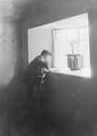 Edwardian man at windowsill