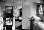 """De luxe cabin of liner """"Orvieto"""", looking from bedroom to sitting room"""