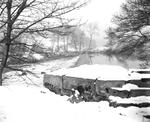 Weir on a river, in snow.