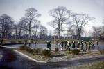Children playing on frozen paddling pond, Zetland Park