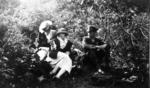 Capt James Fitz Morris with two women