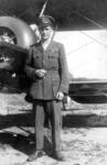 Capt James Fitz Morris in front of aeroplane