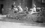 Women knitting in street