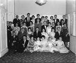 Group of men and women dressed for a night out