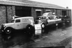 Vehicles parked at Millar's Garage, Callendar Rd, Falkirk, advertising the Ford Prefect and Millar's Garage