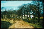 Carron House through trees from River Carron