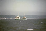 Green ship in the River Forth near Grangemouth