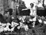 Charlotte Roy feeding birds