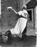 Margaret Roy feeding birds