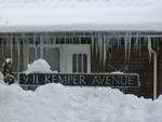Kemper Avenue sign behind deep snow