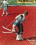 Falkirk District Council Spring Fling - woman helping child on ski slope
