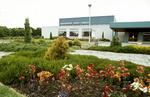 Grangemouth Sports Complex building with flower beds.